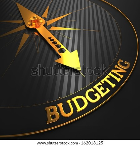 "Budgeting - Business Concept. Golden Compass Needle on a Black Field Pointing to the ""Budgeting"" Word. - stock photo"