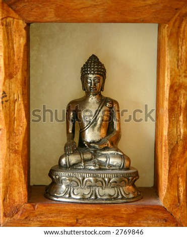 Budha Statue with wood frame - stock photo
