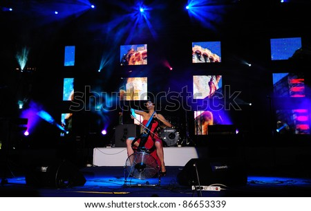 BUDVA, MONTENEGRO - JULY 13: Croatian cello player Ana Rucner performs celebration of Statehood Day of Montenegro on July 13 in Budva, Montenegro