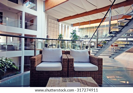 BUDVA, MONTENEGRO - JULY 17, 2011: Modern hotel lobby with armchairs and glass steps in contemporary style, Budva, Montenegro. - stock photo