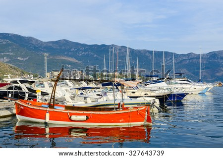 BUDVA, MONTENEGRO - SEPTEMBER 15, 2015: Pleasure boats and yachts at the pier on the waterfront of the popular resort of Budva, Montenegro