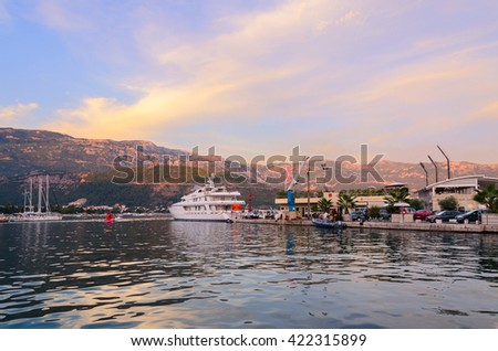BUDVA, MONTENEGRO - SEPTEMBER 15, 2015: Pleasure yachts at the pier Dukley Marina on the promenade of the popular resort of Budva, Montenegro - stock photo