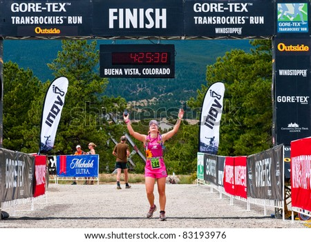 BUENA VISTA, CO - AUG. 21: Luciana Cox of Brazil finishes the 20.2 mile stage 1 race of the Run3 Gore-Tex TransRockies ultra-marathon in Buena Vista, CO on Aug 21, 2011. - stock photo