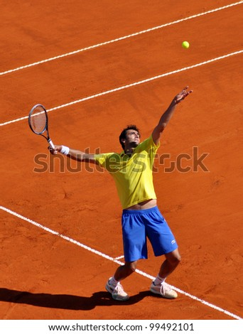 BUENOS AIRES - APRIL 6: Marin Cilic of Croatia serves during Quarter Finals against David Nalbandian of Argentina at Davis Cup on April 06, 2012 in Buenos Aires City. - stock photo