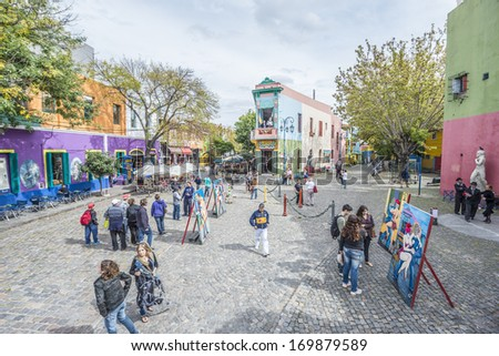 BUENOS AIRES, ARGENTINA - APR 10: People walking near the colorful houses of Caminito street in La Boca on Apr 10, 2013 in Buenos Aires, Argentina. - stock photo