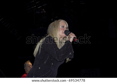 BUENOS AIRES, ARGENTINA - APRIL 4: Singer Cindy Wilson of The B52's perform onstage at Luna Park Stadium April 4, 2009 in Buenos Aires, Argentina. - stock photo