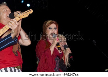 BUENOS AIRES, ARGENTINA - APRIL 4: The B52's perform onstage at Luna Park Stadium April 4, 2009 in Buenos Aires, Argentina. Singer Kate Pierson - stock photo