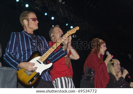 BUENOS AIRES, ARGENTINA - APRIL 4: The B52's perform onstage at Luna Park Stadium April 4, 2009 in Buenos Aires, Argentina. - stock photo