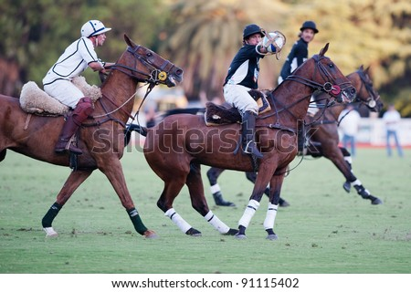BUENOS AIRES, ARGENTINA - DEC 18:  Grand Final of 70th Argentina Horseball Open. La Guarida team (16 points, White Shirt) versus Los Mochitos (14points, Black). Dec 18, 2011 in Buenos Aires, Argentina
