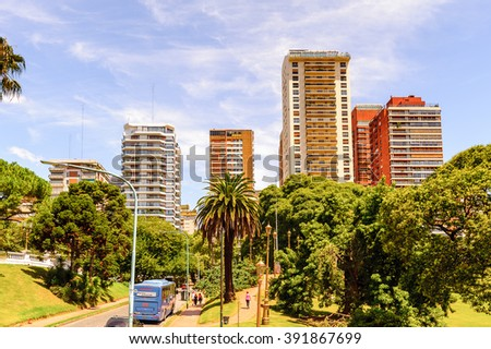 BUENOS AIRES, ARGENTINA - FEB 15, 2014: Building and traffic of the Avenida del Libertador (Liberator Avenue) which is one of the principal thoroughfares in Buenos Aires, Argentina.