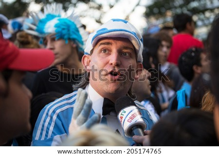 BUENOS AIRES, ARGENTINA - JULY 13, 2014: Soccer fans on the streets of Buenos Aires at the final game of World Cup 2014 between Argentina and Germany. July 13, 2014, Buenos Aires, Argentina