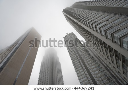 Buenos Aires, Argentina - Jun 28, 2016: Renoir Towers. Downtown skyscrapers under the fog upward view at the Puerto Madero.