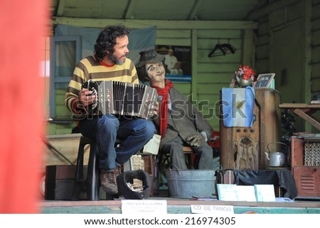 Buenos Aires, Argentina - March 23,2014 : Musician with Accordion in La Boca neighborhood, Argentina - stock photo