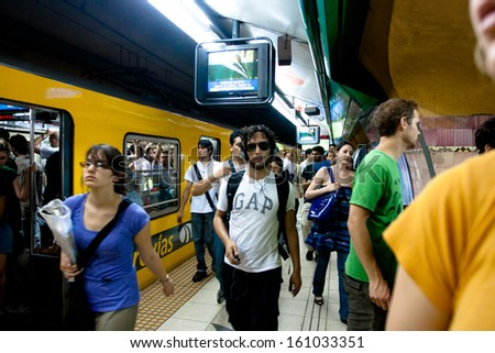 BUENOS AIRES, ARGENTINA - NOV 30: Scene in the Buenos Aires subway, Nov 30, 2010 in Buenos Aires, Argentina. Rapid transit system of lines opened Dec 1, 1913. Passenger traffic for year 329 million. - stock photo