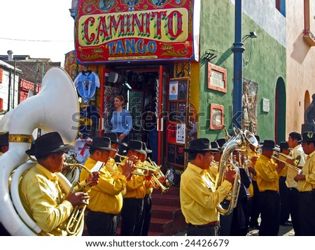BUENOS AIRES, ARGENTINA - OCTOBER 12: A street band plays in the La Boca district of Buenos Aires, Argentina October 12, 2006. La Boca is a tourist attraction and where the Tango originated. - stock photo