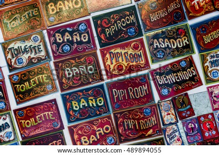 BUENOS AIRES, ARGENTINA - SEPTEMBER 25, 2016: Colorful door signs in fileteado style