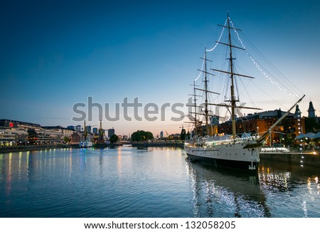 BUENOS AIRES - CIRCA NOVEMBER 2012: Historic Fragata Sarmiento, docked in Puerto Madero at night, circa November 2012. This is a popular tourist destination with over 2.5 million yearly visitors . - stock photo