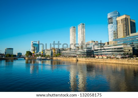 BUENOS AIRES - CIRCA NOVEMBER 2012: Skyline in the neighborhood of Puerto Madero, circa November 2012. This is a popular tourist destination with over 2.5 million yearly visitors . - stock photo