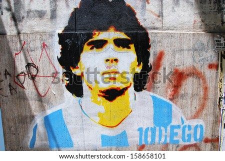 BUENOS AIRES NOV 24: Diego maradona graffiti on November 24, 2011 in Buenos Aires. The walls of the Argentine city enlivened by murals, whimsical painted figures, graffiti and stencils - stock photo