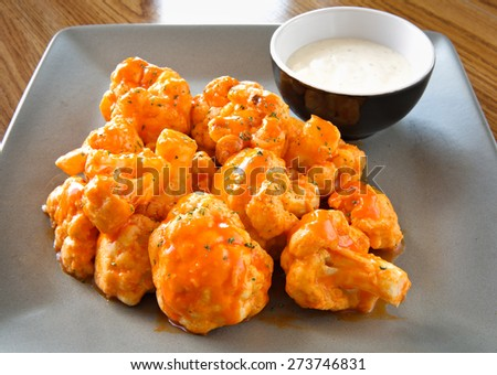 buffalo cauliflower with ranch dipping sauce - stock photo