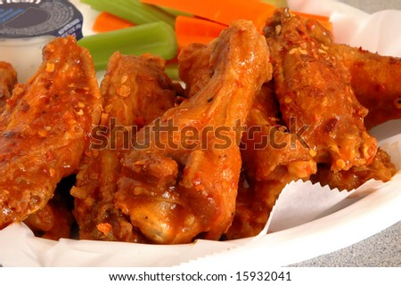Buffalo chicken wings with celery and carrots - stock photo