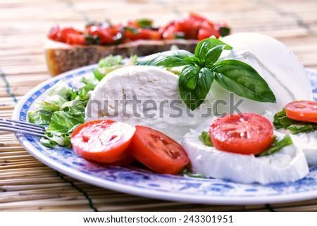 Buffalo Mozzarella with salad - stock photo