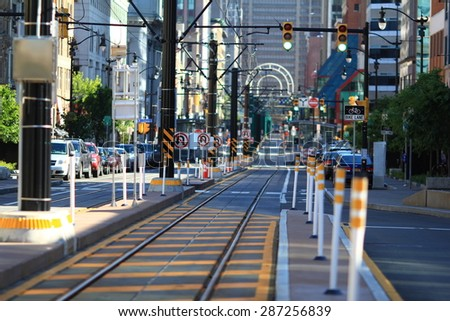 BUFFALO, NEW YORK - JUNE 3, 2015: Looking south down Main Street in downtown Buffalo, New York during late afternoon. NFTA light rail cables and track visible. - stock photo