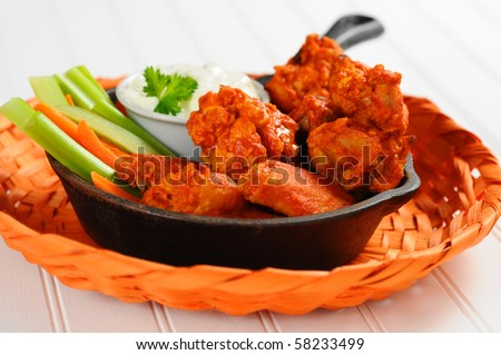 Buffalo style chicken wings and fresh vegetables. - stock photo
