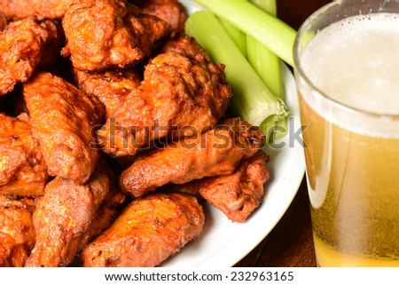 Buffalo Wings with Celery Sticks and Beer - stock photo