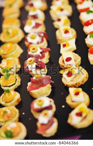 buffed food closeup of  fruits, vegetables, meat and fish arranged on banquet table - stock photo