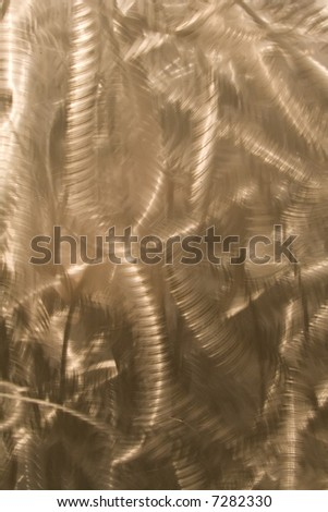 Buffed scratches for an abstract design on this metal elevator door.