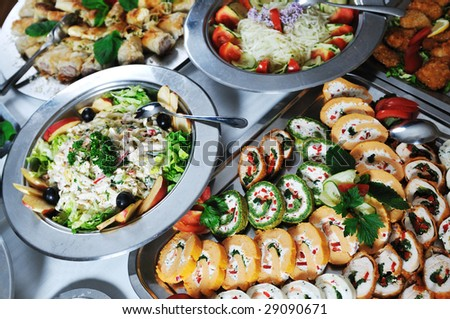 buffet catering food arangement on table - stock photo
