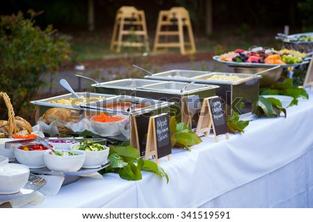Buffet dinner at a wedding reception with pasta and toppings. - stock photo