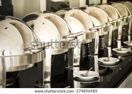 Buffet heated trays in the line. - stock photo