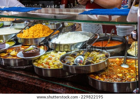 Buffet lunch in Turkish restaurant  of bulgur, coos coos, peppers, stews, soup and meat dishes, near  Pergamum, Turkey - stock photo