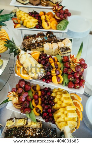 Buffet reception with fruit at the wedding - stock photo