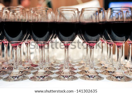 buffet red wine in glasses ready to served, catering - stock photo