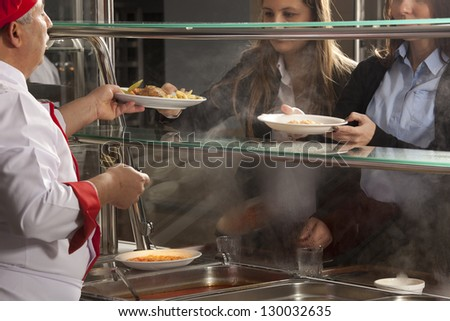 buffet self-service food display human hand take plate