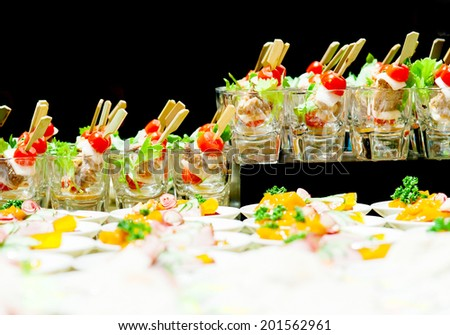 Buffet style food in trays - stock photo