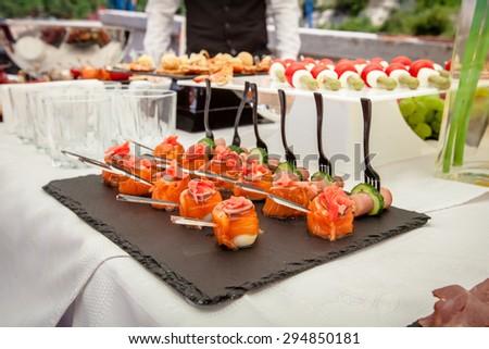 Buffet table closeup. Salmon canapes  - stock photo