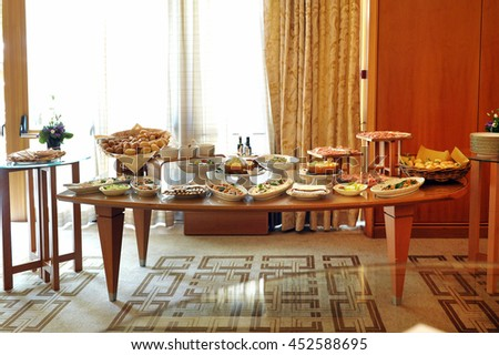 Buffet Table Laden With A Selection Of Food In Restaurant Or Hotel Cold Meats
