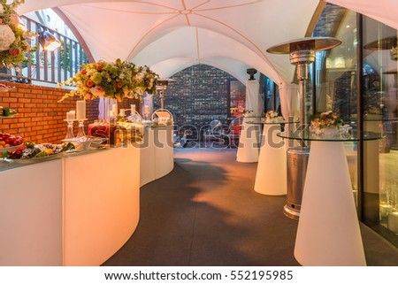 Buffet table of reception with fruits, cold snacks, meat and salads