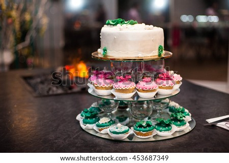 buffet table of tasty sweet cakes  - stock photo