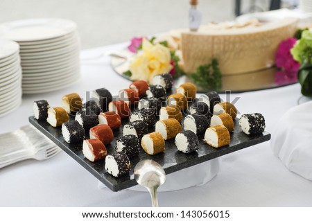 buffet table with a variety of cheeses - stock photo