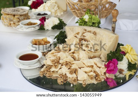 buffet table with Parmesan cheese in pieces with nuts - stock photo