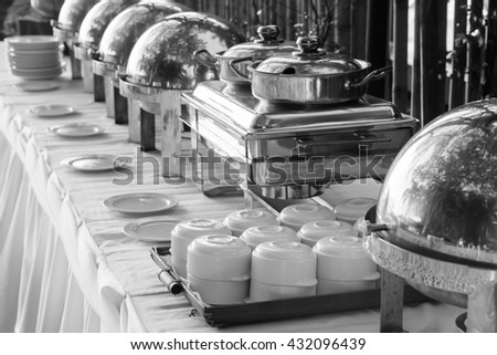 Buffet Table with Row of Food Service Steam Pans(Black and White) - stock photo