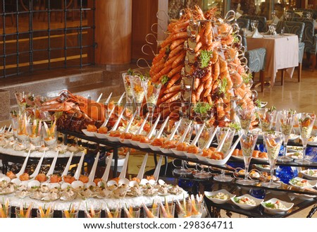 Buffet table with seafood with shrimp - stock photo