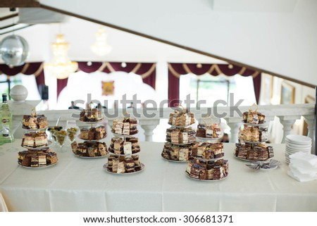 buffet table with traditional sweets and cakes on the background luxury restaurant - stock photo
