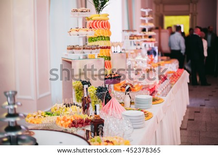 Buffet with a variety of delicious sweets, food ideas, celebration - stock photo