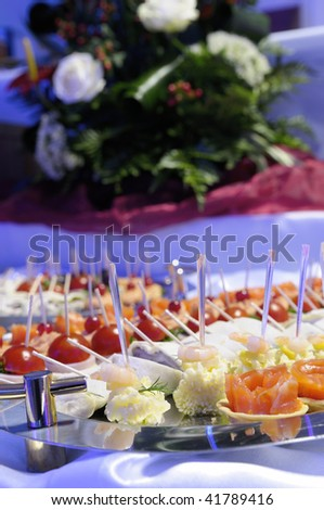 Buffet with different light snacks. - stock photo